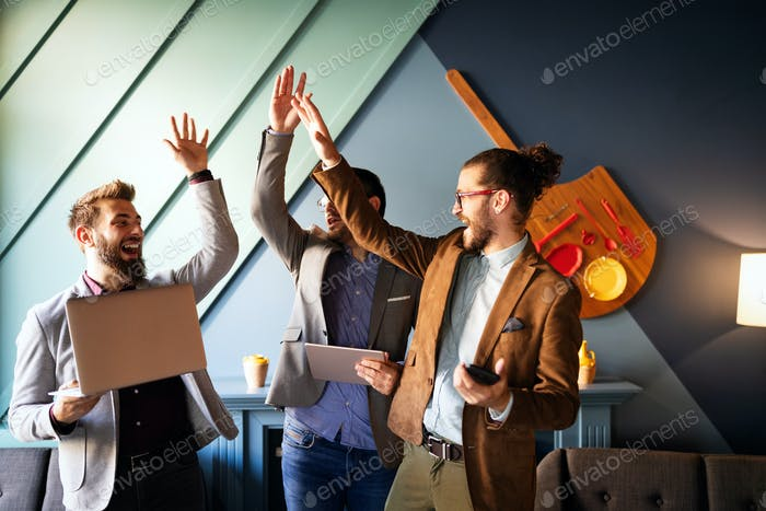 Happy successful business man giving a high fives gesture as cheer their success