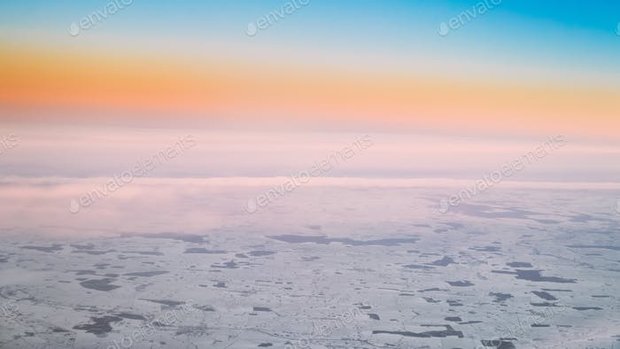 Aerial View From High Altitude Flight Of Aircraft On Snow-covere