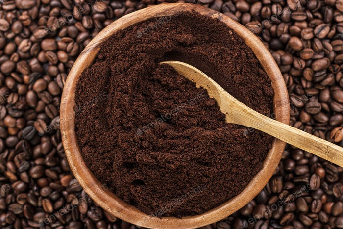 Coffee Beans And Wooden Bowl Full Of Ground Coffee