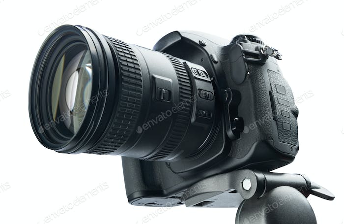 DSLR camera on tripod, isolated  white background