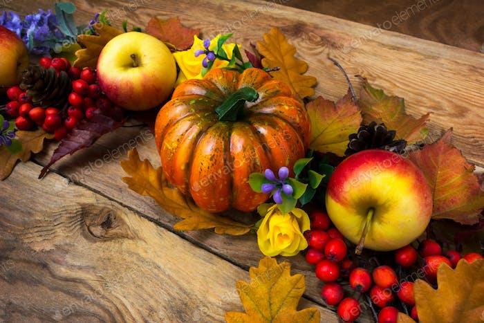 Fall wreath with pumpkin, purple flowers, apples