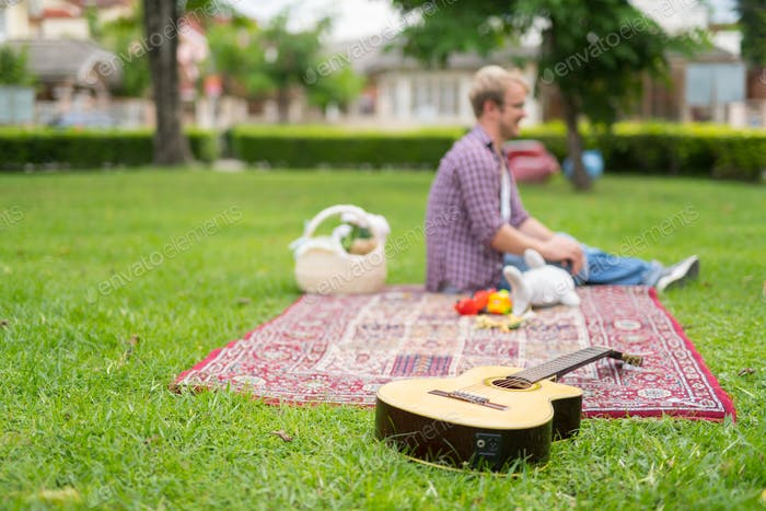 Portrait of man having picnic and relaxing outdoors