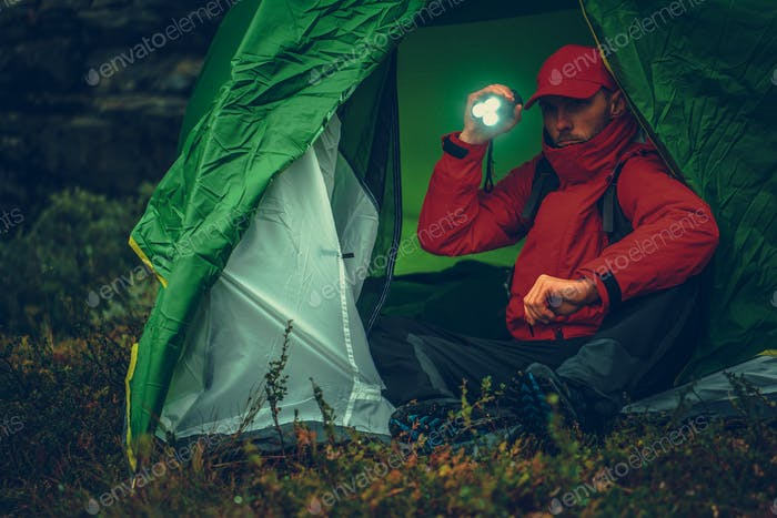 Camper with Flashlight