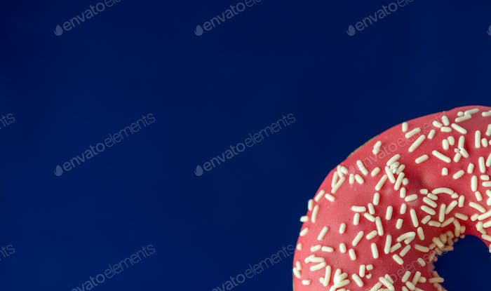 Blue background with pink donut