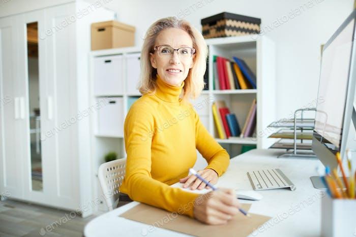 Mature Businesswoman at Desk