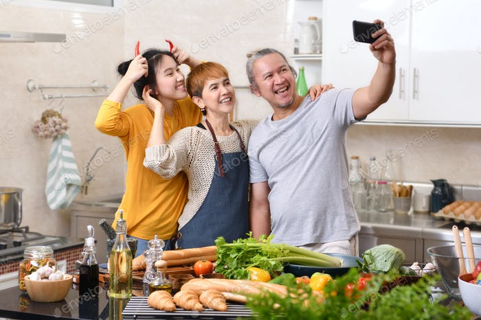 Family cooking in kitchen together