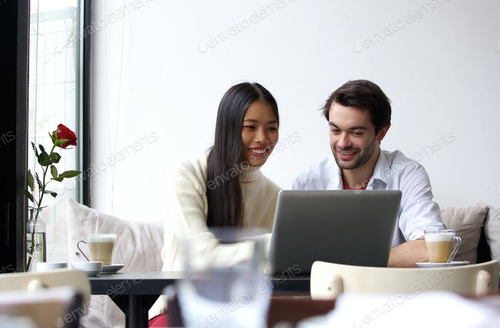 Young man and woman working on laptop