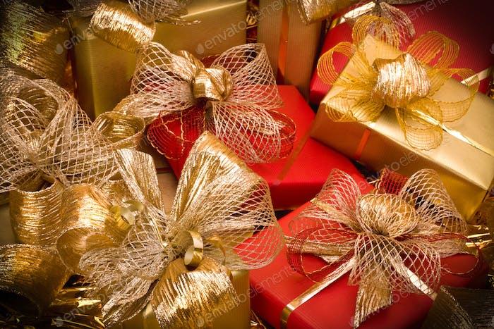 Christmas background. Shiny gifts.