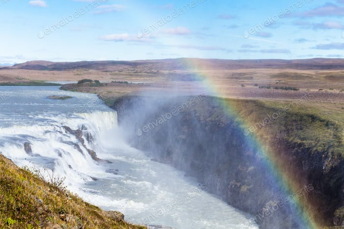 rainbow over Gullfoss waterfall in canyon