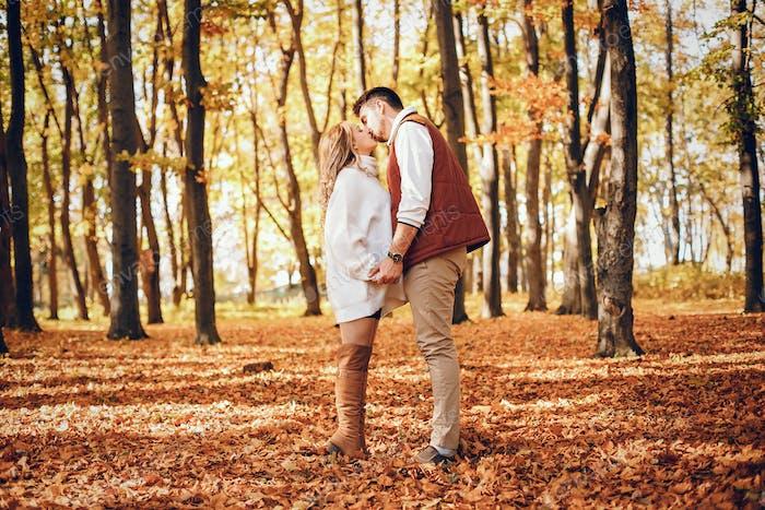 Elegant couple in a sunny autumn park
