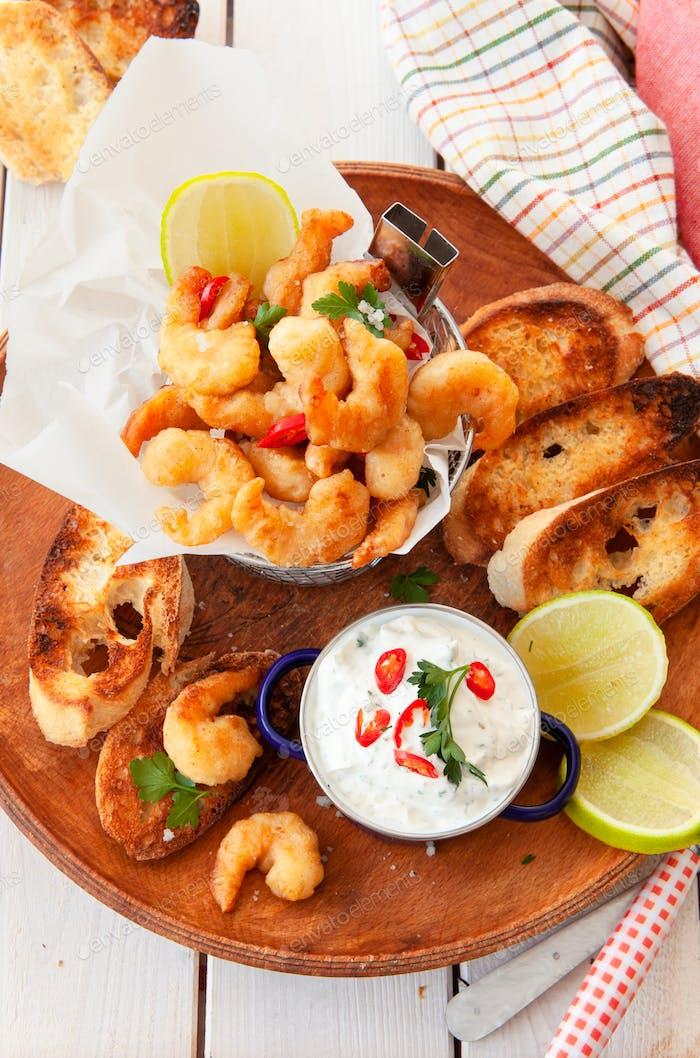 Delicious popcorn shrimps with garlic dip