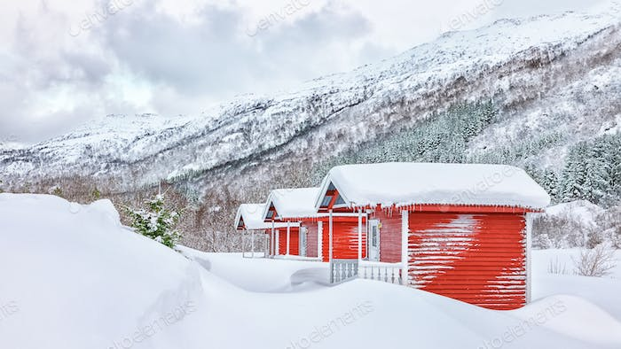 Traditional Norwegian architecture and winter scenery with red wooden houses on Lofoten Islands