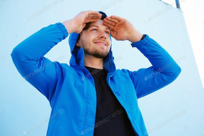 Positive man in blue hoodie
