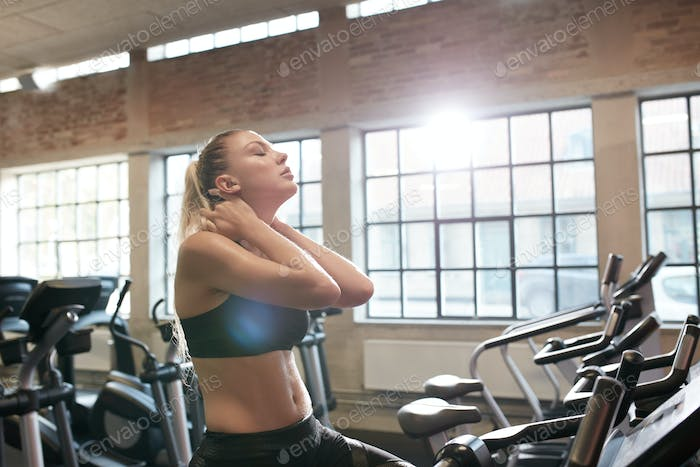 Woman tired after intense workout on gym bike