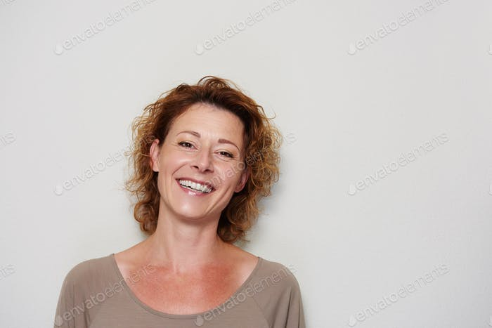 Smiling brunette woman on white background