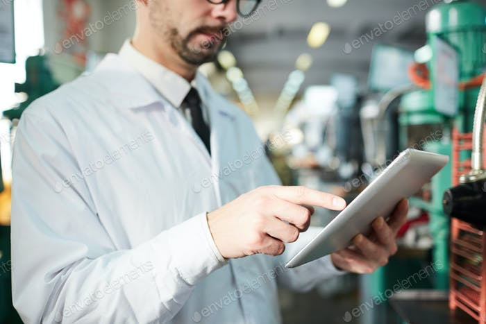 Factory Worker Holding Tablet
