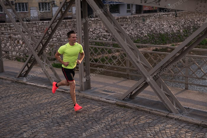a young man jogging in the city