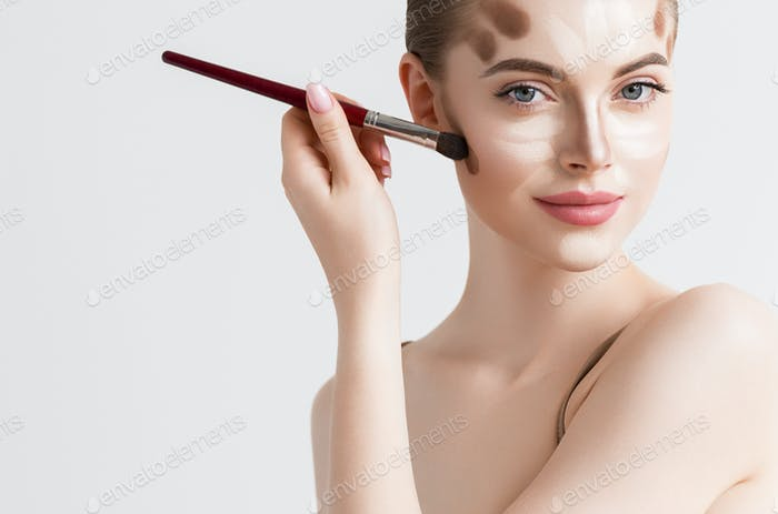 Make up woman face cosmetic applying