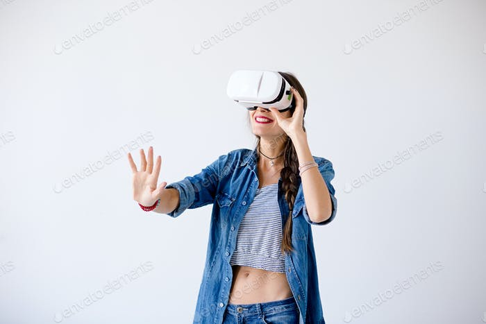 Laughing girl with VR glasses