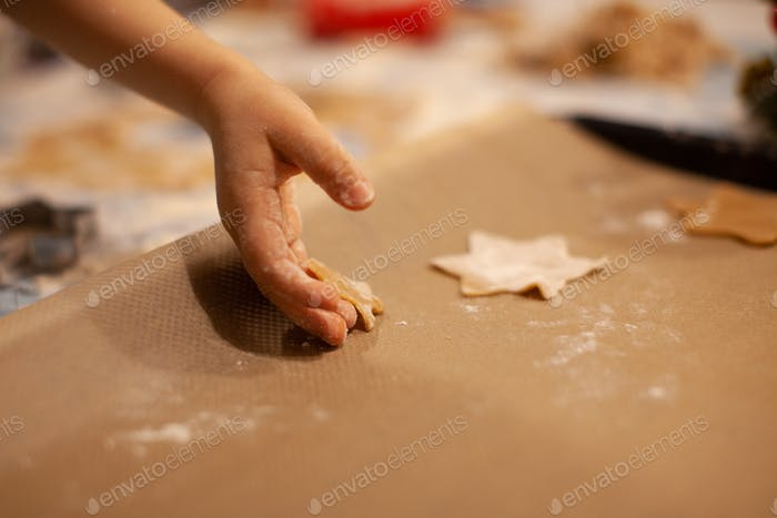 A child prepares ginger cookies on New Year's Eve