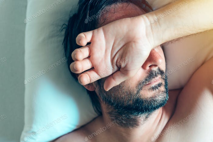Morning depression and midlife crisis with man in bed