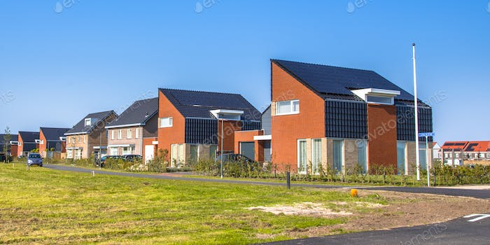 Modern houses in new building project