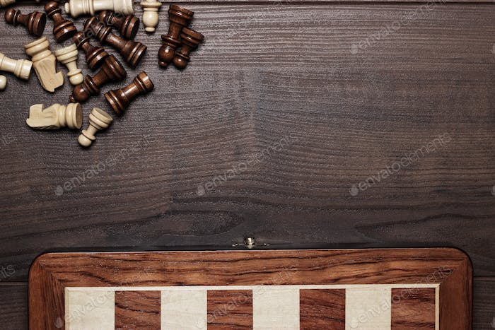 Chess Board And Some Figures On Wooden Background