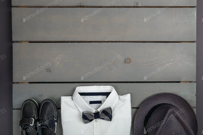 Men's outfit on wooden background. Kids fashion clothes