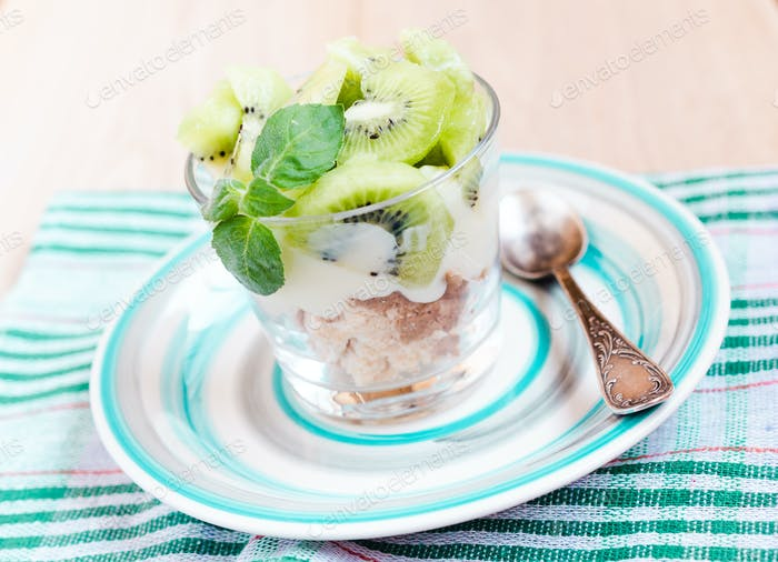 Kiwi Eton mess - dessert with meringue, whipped cream and fruits