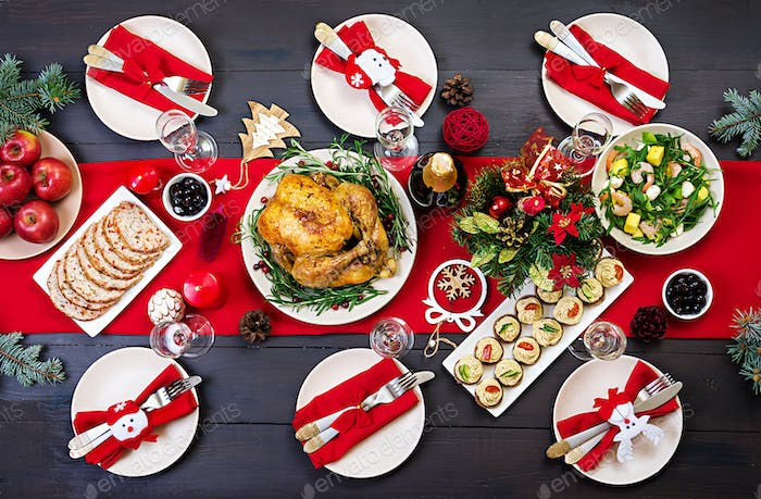 Baked turkey. Christmas dinner. The Christmas table is served with a turkey