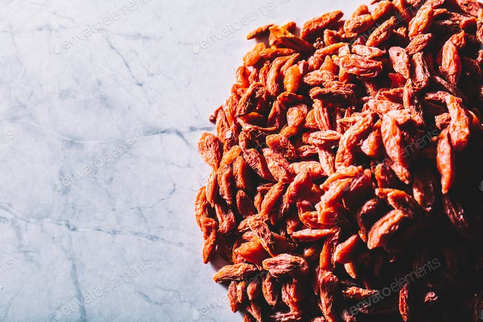 Little red dried goji berries on a pile. Superfoods
