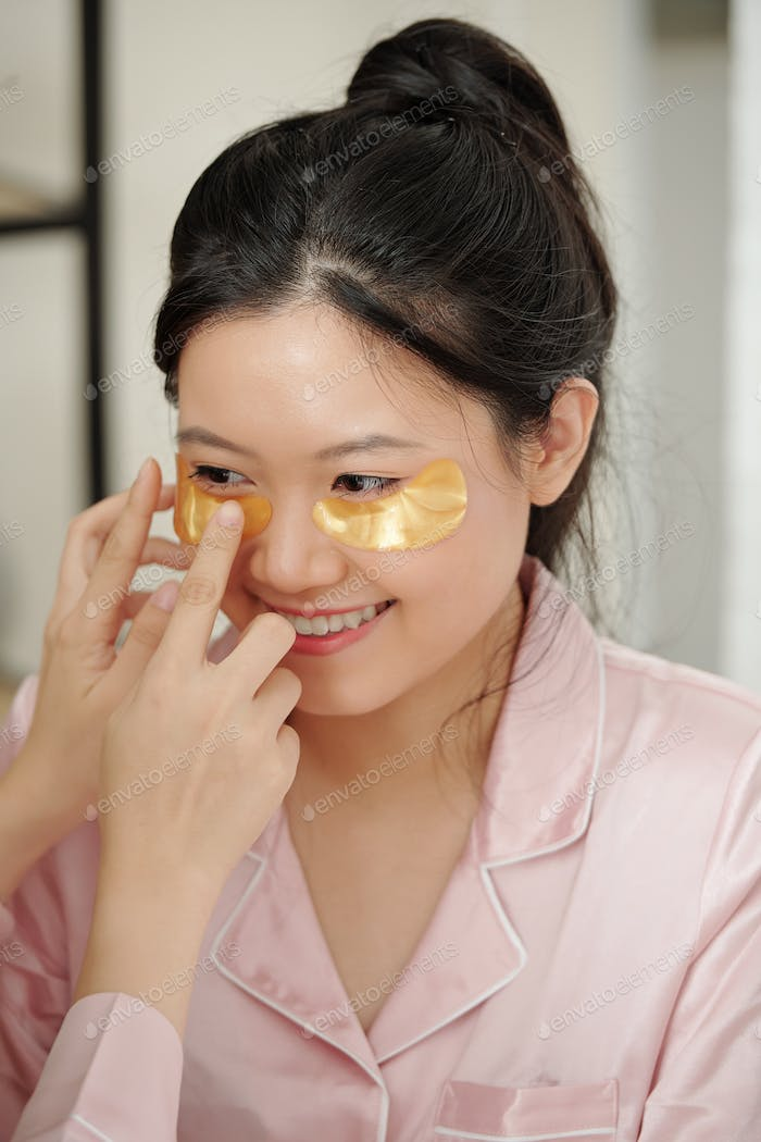 Woman getting collagen pads applied