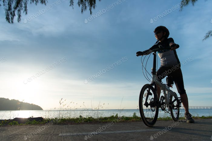 Silhouette cyclist at sunset