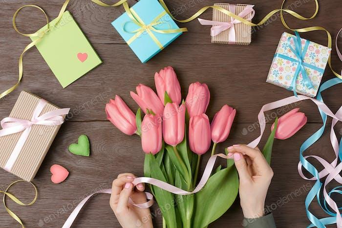 Tulips on wood
