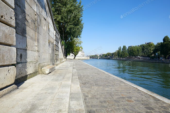 Paris, empty Seine river docks, wide angle view in a sunny day