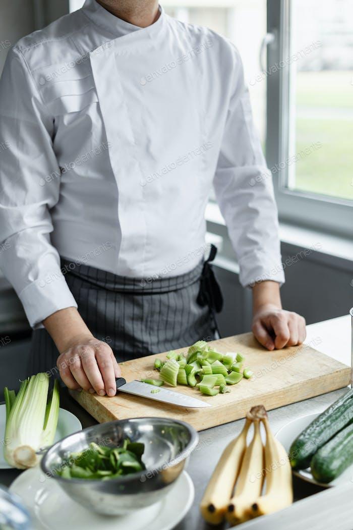 Crop shot of chef making vegetable smoothie