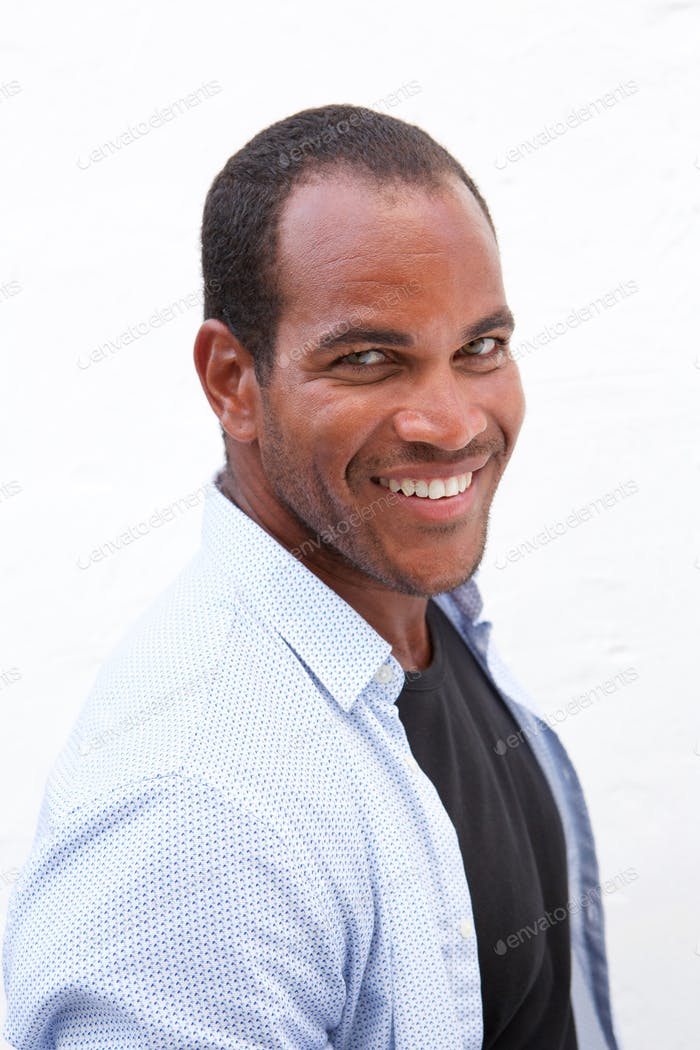 Close up attractive confident man laughing on white background