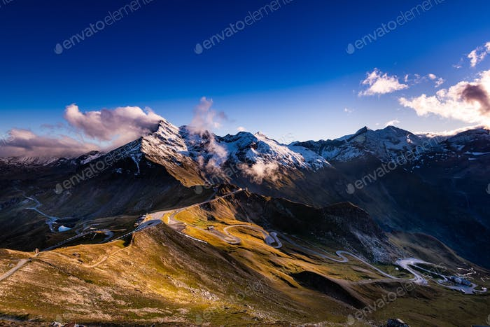 Panoramic View Over High Alpine Road and Snowy Mountains Peaks