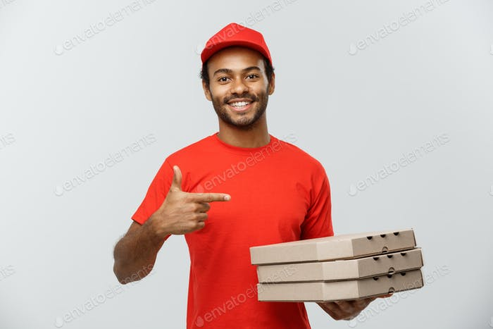 Delivery Concept - Portrait of Happy African American delivery man pointing hand to present pizza