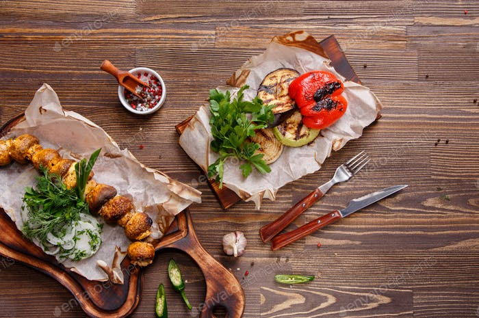 Grilled vegetables on a wooden table.