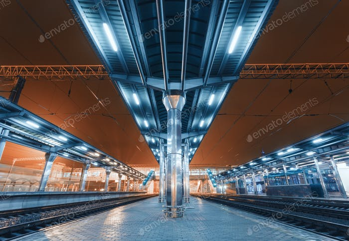 Modern futuristic railway station with illumination