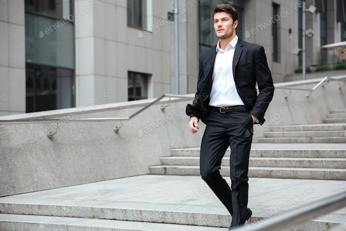 Businessman in suit walking on the street