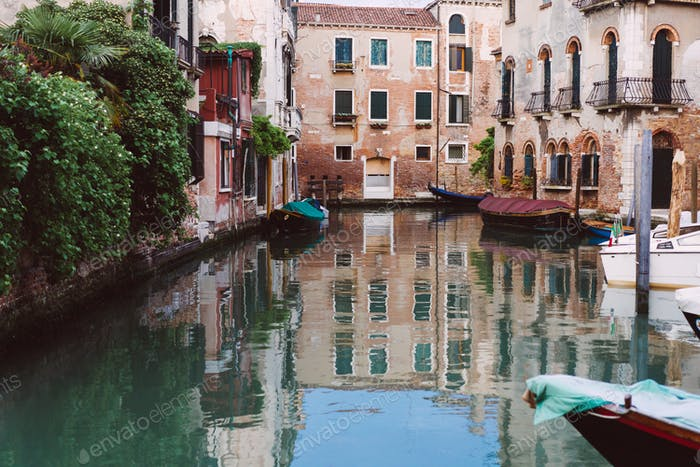 Venetian canals, old houses and moored boats