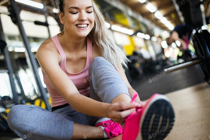 Image of attractive fit woman in gym