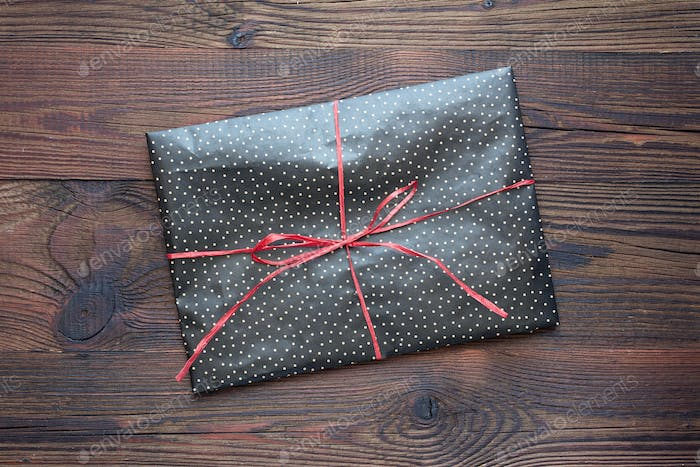 wrapped gift on a wooden table