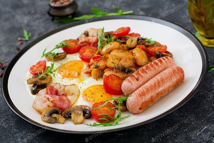 English breakfast - fried egg, beans, tomatoes, mushrooms, bacon and sausage. Tasty food.