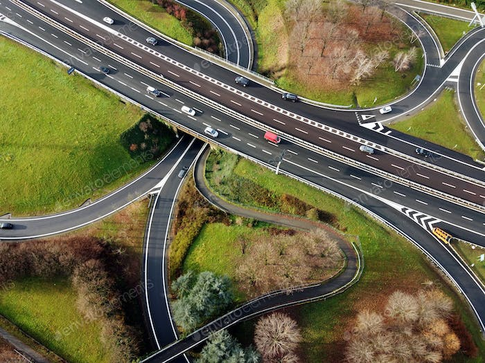 Aerial view of curvy road junctions and highway