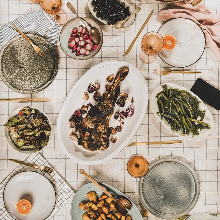 Flat-lay of meat, salads, snacks and blooming mimosa, square crop