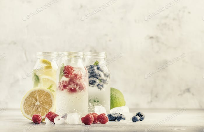 Berry and citrus fruit infused summer cold drinks