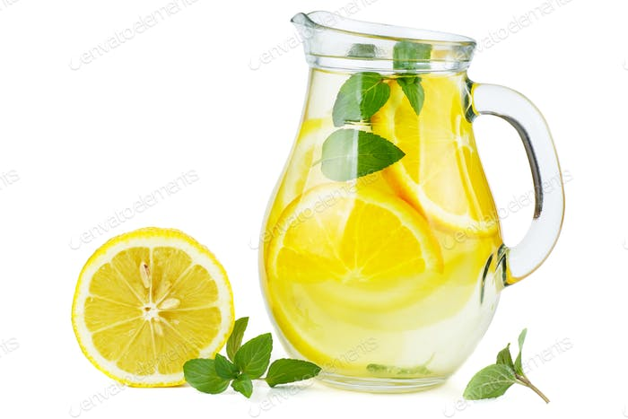 Glass jug with lemon water (or alcohol), slices and mint